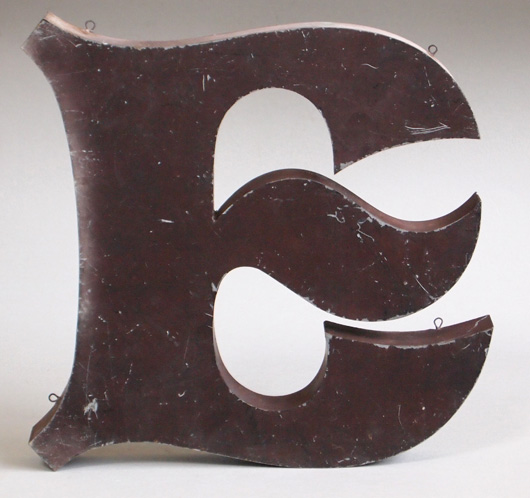 Stylised metal shop sign letter 'E', mid-1900s