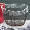Large wire fishing basket with swing handles, early 1900s