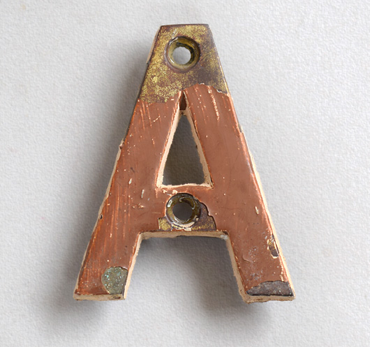 Small vintage brass sign letter 'A' painted brown, early 1900s
