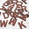 Assorted small brass sign letters painted brown, early 1900s