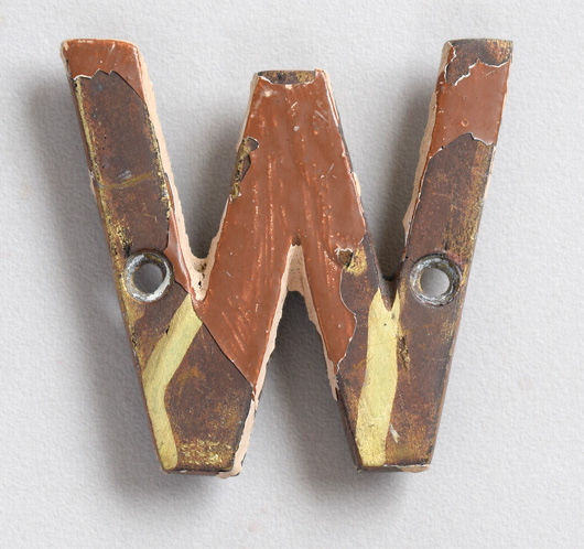 Small vintage brass sign letter 'W' painted brown, early 1900s