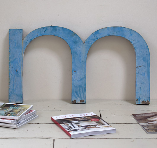 Extra-large lowercase metal sign letter 'm' or 'w'