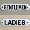 Pair of early-1900s enamel lavatory signs