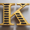 Large gold-gilt wooden letter 'K', ex-Thomas Pink