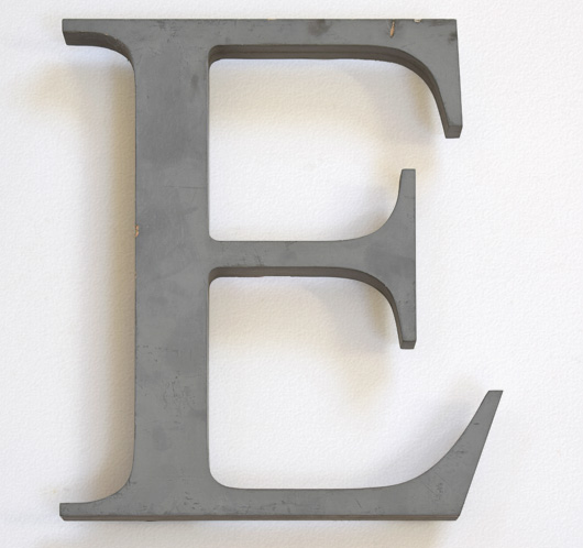 Large green vintage wooden shop sign letter 'E', mid-1900s