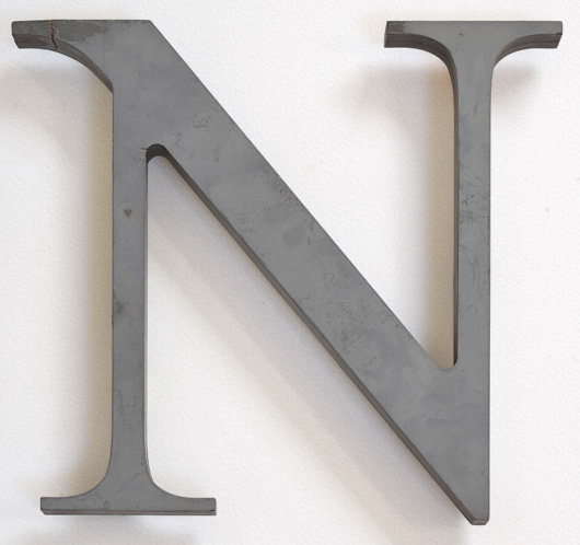 Large green vintage wooden shop sign letter 'N', mid-1900s