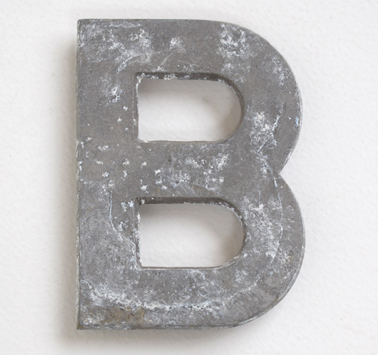 Early vintage cast-metal car number plate letter 'B'