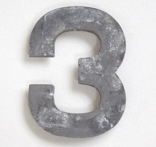 Early vintage cast-metal car number plate number '3'