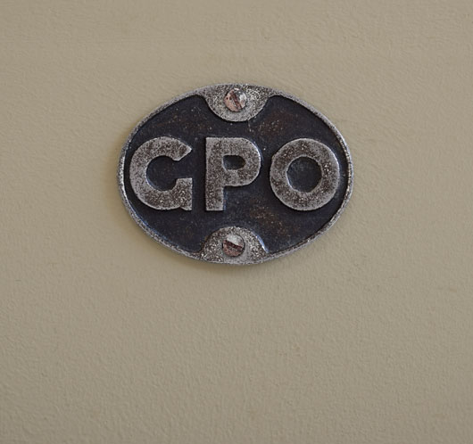 Early-1900s stripped cast-iron sign: GPO