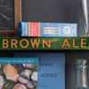 Early-1900s tin shelf sign: Watney's Brown Ale