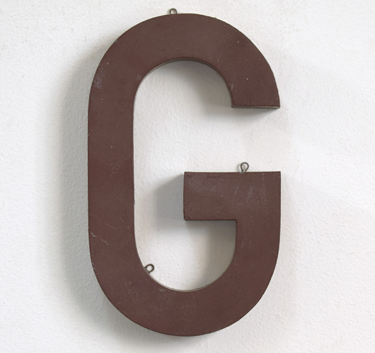 Chocolate-brown French zinc sign letter 'G'