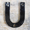 Mid-1900s monochrome metal sign letter 'U'