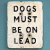 Painted metal sign: Dogs Must Be On Lead