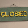 Early-1900s wood and iron sign: Closed