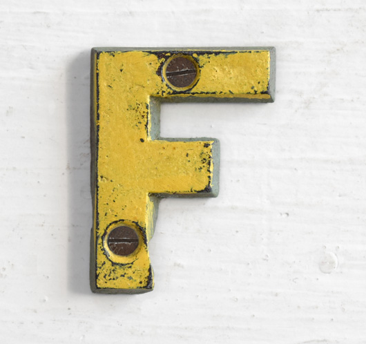 Antique Victorian painted yellow iron sign letter: F
