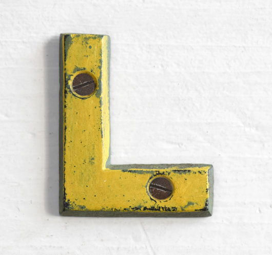 Antique Victorian painted yellow iron sign letter: L