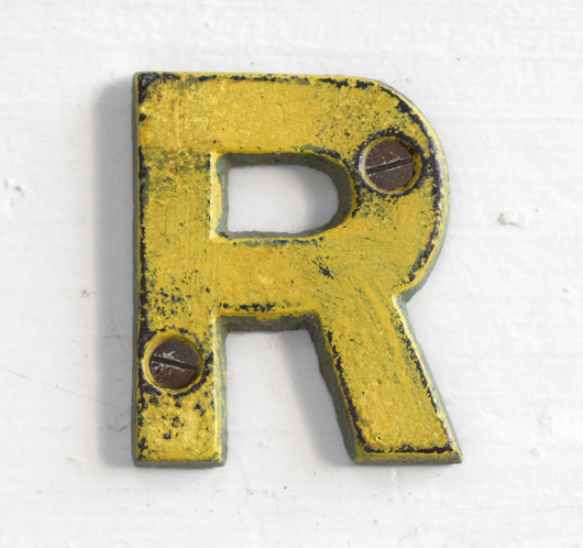 Antique Victorian painted yellow iron sign letter: R