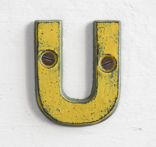 Antique Victorian painted yellow iron sign letter: U
