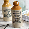 Stoneware ginger beer bottle: M. Whittaker, c. 1900