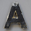 Early-1900s black & white metal sign letter: A