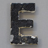 Early-1900s black & white metal sign letter: E