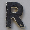 Early-1900s black & white metal sign letter: R