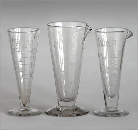 Set of 3 vintage glass pouring measures, hand-etched