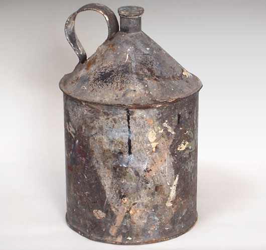 Early-1900s vintage zinc metal fuel can with paint splashes