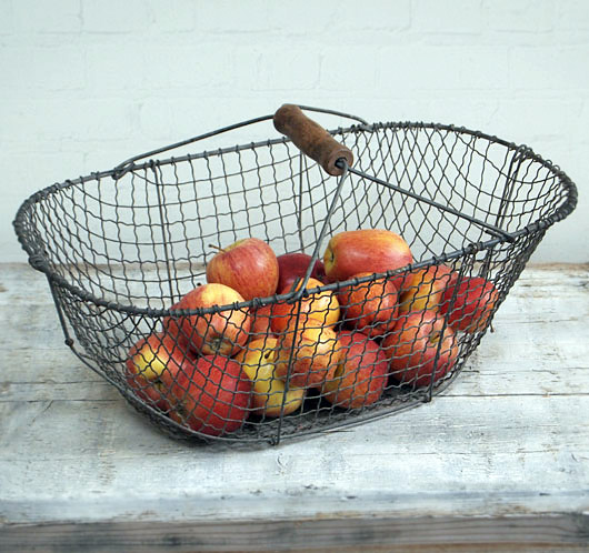 Large antique wire vegetable basket with turned wooden handle