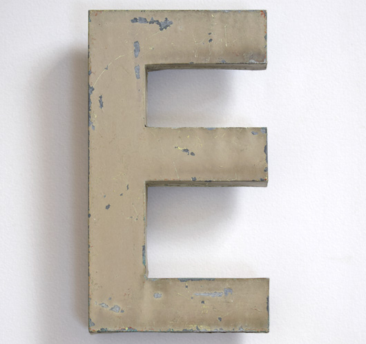 Early-1900s vintage French painted zinc shop sign letter 'E'