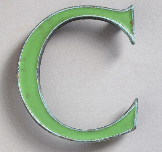 Vintage small green enamel and brass letter 'C', c. 1910