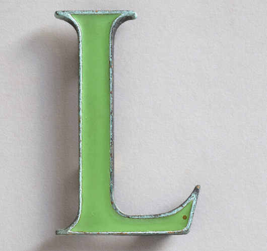 Vintage small green enamel and brass letter 'L', c. 1910
