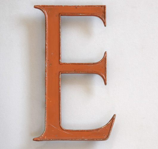 Vintage painted enamel and brass sign letter 'E', c. 1910