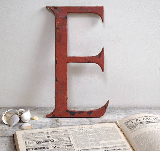 Large painted brass sign letter 'E', c. 1900