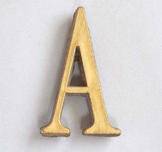 Small vintage gold resin sign letter 'A', c. 1930s