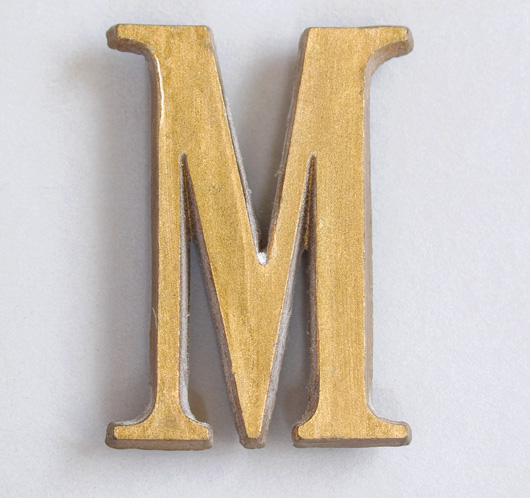 Small vintage gold resin sign letter 'M', c. 1930s