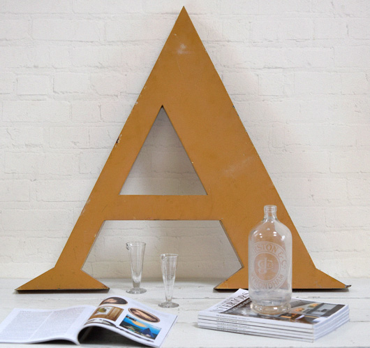Very large vintage metal company sign letter 'A'