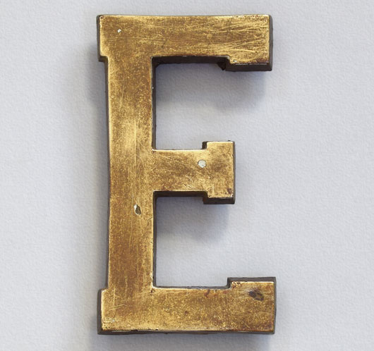 Early-1900s antique brass sign letter 'E', 14cm