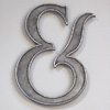 Large cast-metal ampersand symbol, early 1900s