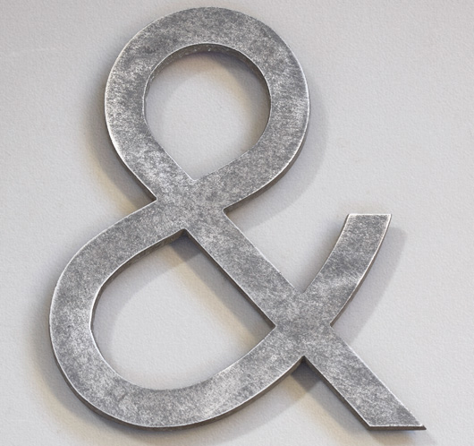 Early-1900s stripped vintage metal ampersand symbol