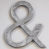 Early-1900s stripped metal ampersand symbol
