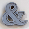 Small painted cast-metal ampersand symbol