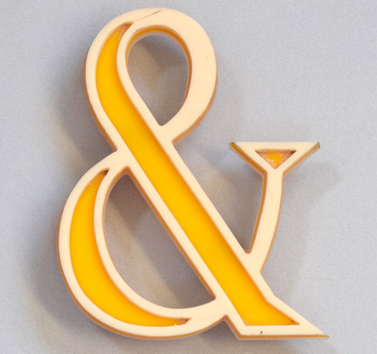 Vintage yellow and cream acrylic ampersand symbol