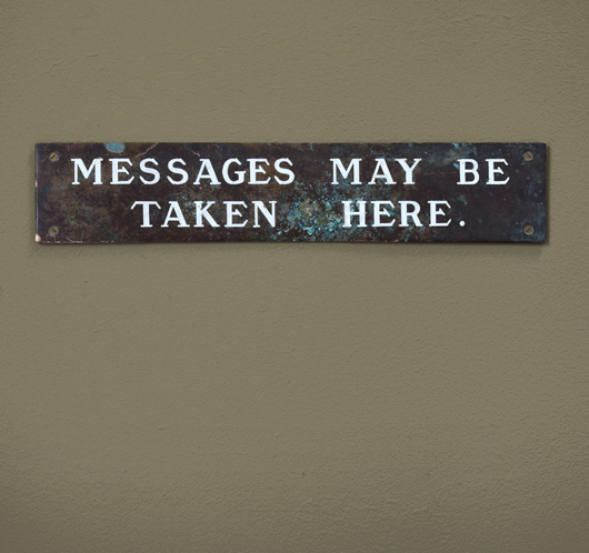 Antique brass and enamel sign: Messages May Be Taken...