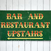 Hand-painted wooden sign: Bar And Restaurant...