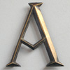 Early-1900s stylised brass sign letter 'A'