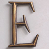 Early-1900s stylised brass sign letter 'E' (style 2)