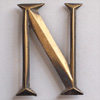 Early-1900s stylised brass sign letter 'N' (style 2)