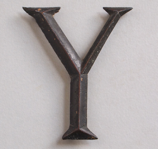 Early-1900s stylised vintage brass sign letter 'Y', tarnished