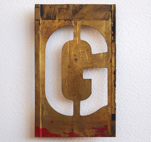 Early-1900s vintage brass plate letter stencil: 'G'